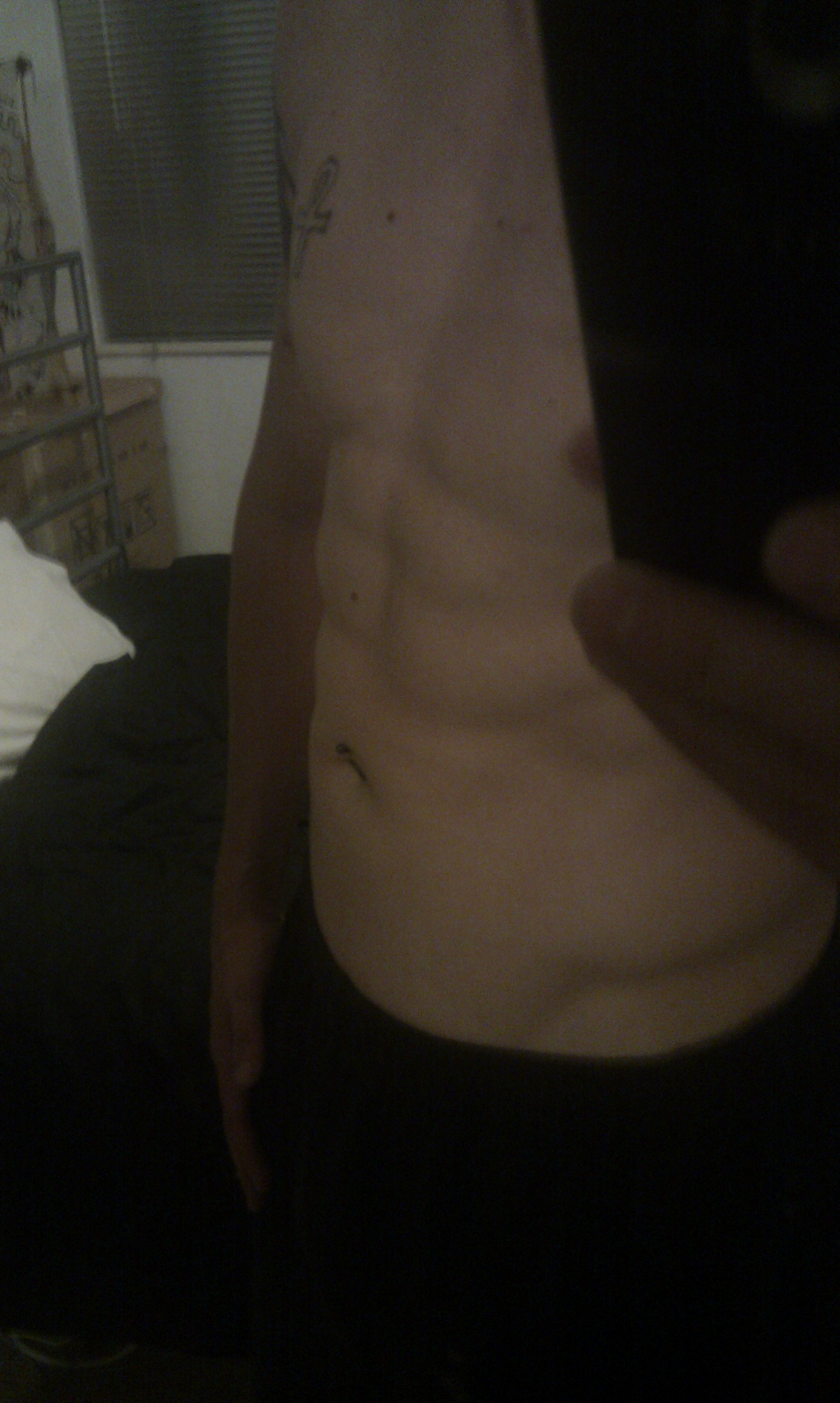 Photo of my torso, displaying a hint of abs.